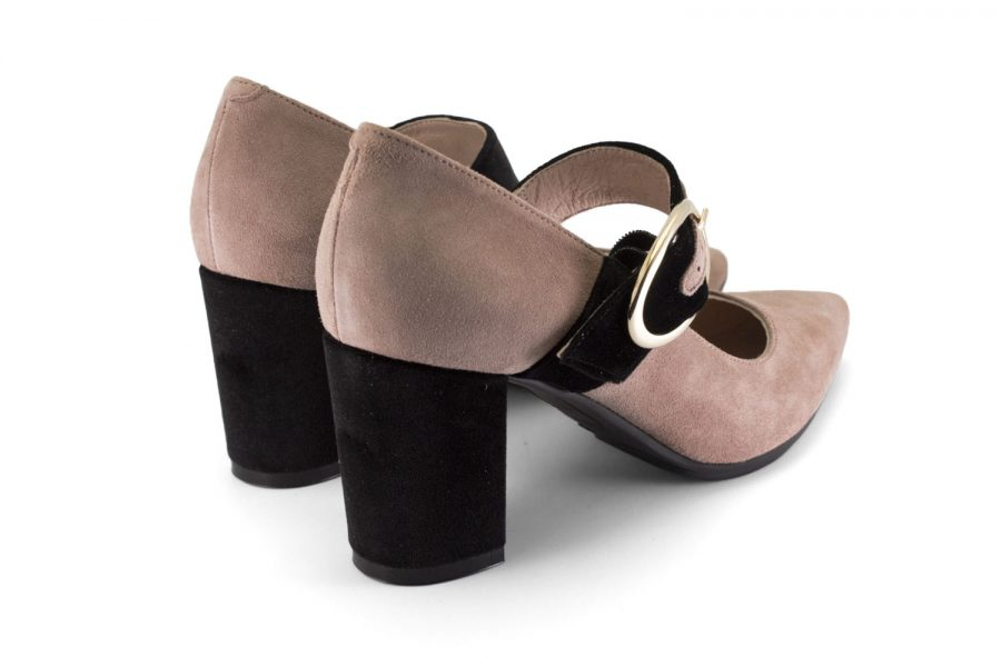Comfortable leather shoes in nude and black with a Mary Jane buckle